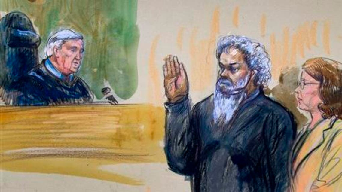 This June 28, 2014, artist's rendering shows United States Magistrate, Judge John Facciola, swearing in the defendant, Libyan militant Ahmed Abu Khatallah, wearing a headphone, as his attorney Michelle Peterson watches during a hearing at the federal U.S. District Court in Washington. The Libyan militant now in U.S. custody in the Benghazi attacks was motivated to do so by his extremist ideology, the government said Tuesday, July 1. In the days before the attacks, Ahmed Abu Khattala voiced concern and opposition to the presence of an American facility in Benghazi, according to a federal court filing. (AP Photo/Dana Verkouteren)