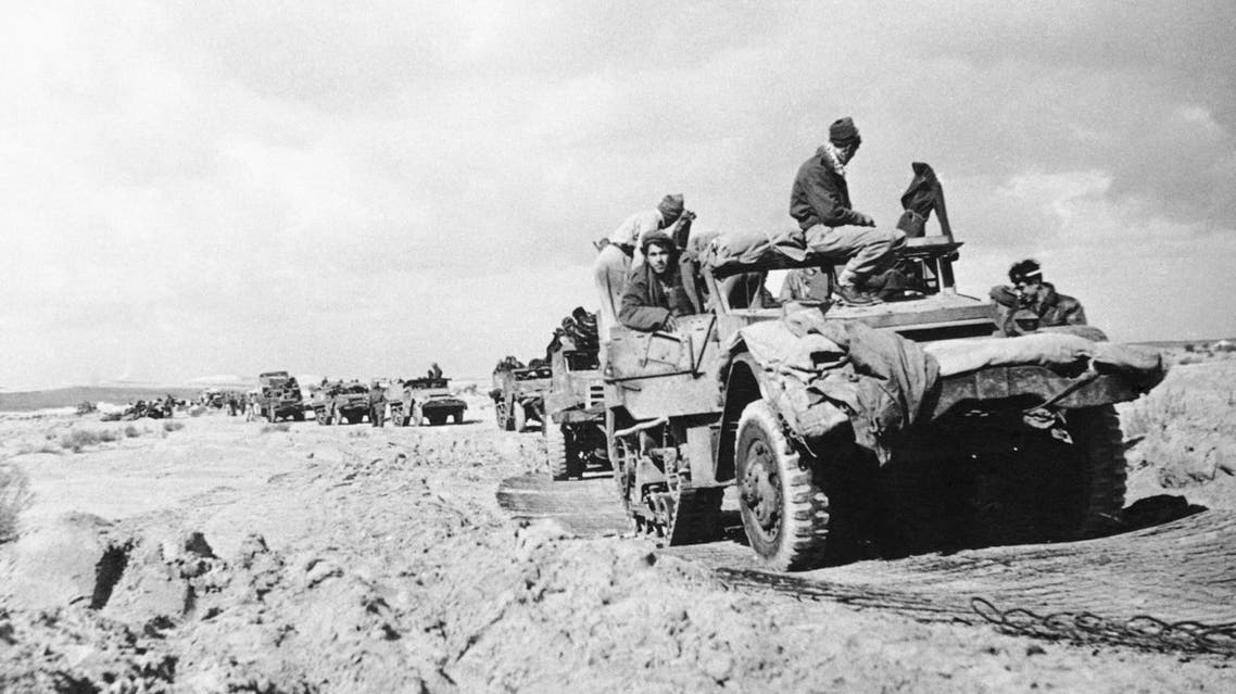 A column of Israeli army half tracks travel through the Negev Desert area of Palestine during recent action against the Egyptians, Jan. 6, 1949. (AP)