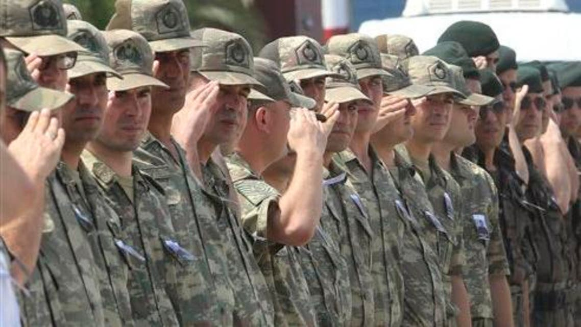 Turkish soldiers salute as the coffin of police officer Ahmet Camur arrives in the Black Sea city of Trabzon, Turkey for his funeral, Sunday, Aug. 16, 2015. (AP)
