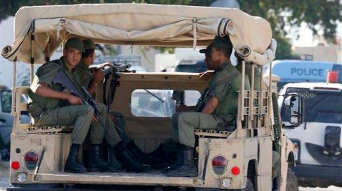 Tunisian army patrol near the attacked Imperial Marhaba hotel in Sousse, Tunisia, Saturday, June 27, 2015.