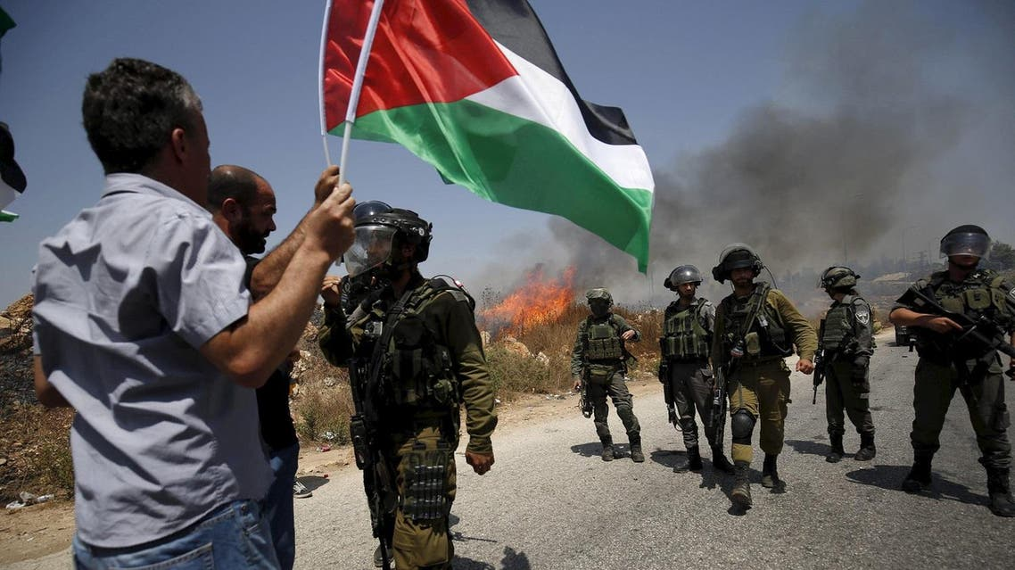 Palestinian protesters argue with Israeli soldiers duringg clashes at protest against Jewish settlements in the West Bank village of Nabi Saleh, near Ramallah August 7, 2015