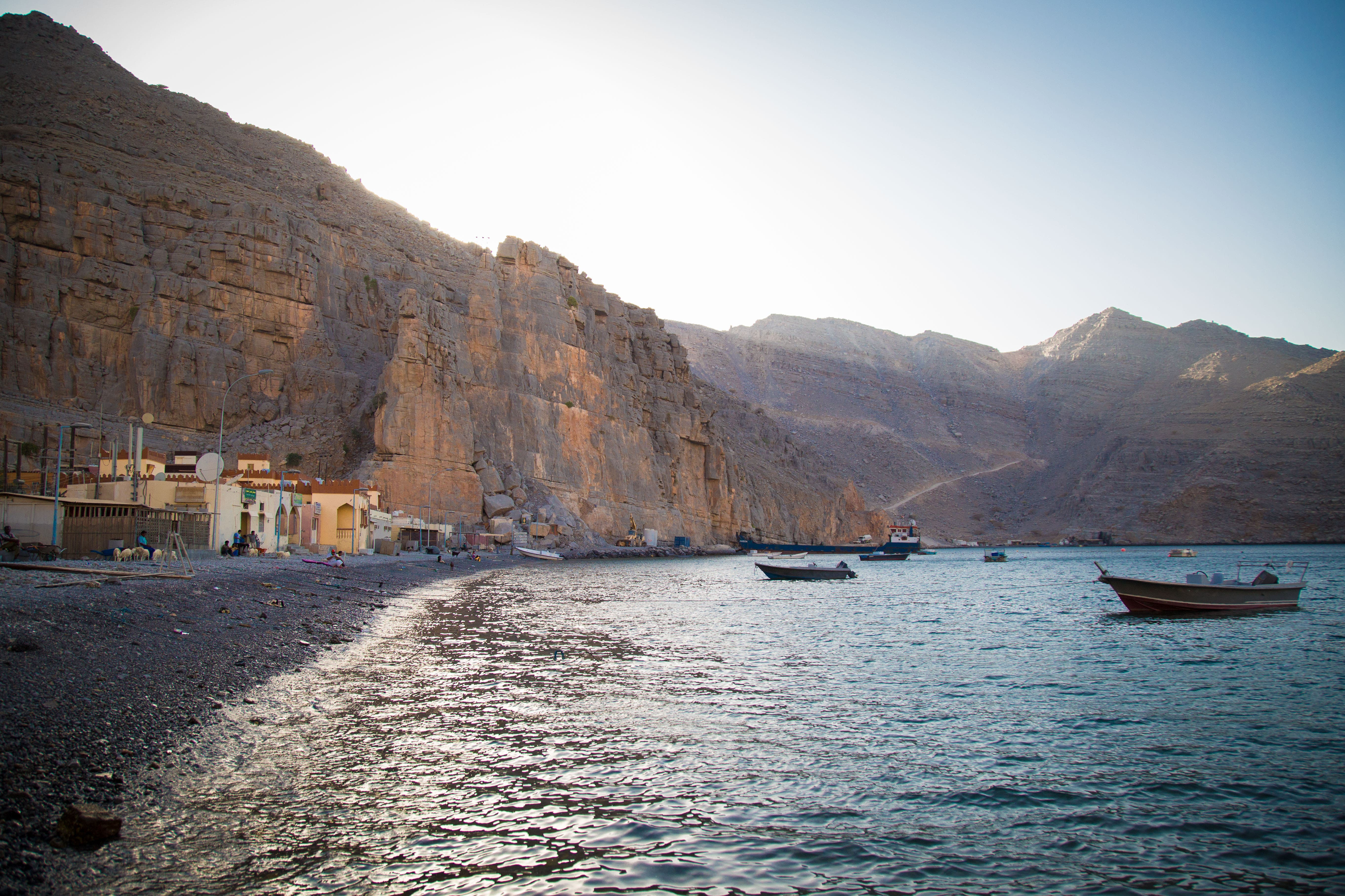 Kumzar's seashore, with the beginnings of the mountain road visible to the right. (Amanda Fisher/Al Arabiya News)