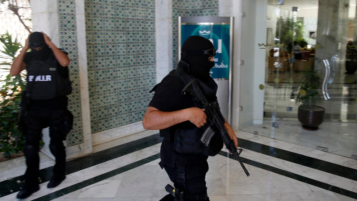 Tunisian police officers guard the Imperial Marhaba hotel during visit of top security officials of Britain, France, Germany and Belgium in Sousse, Tunisia, Monday, June 29, 2015. (Reuters)