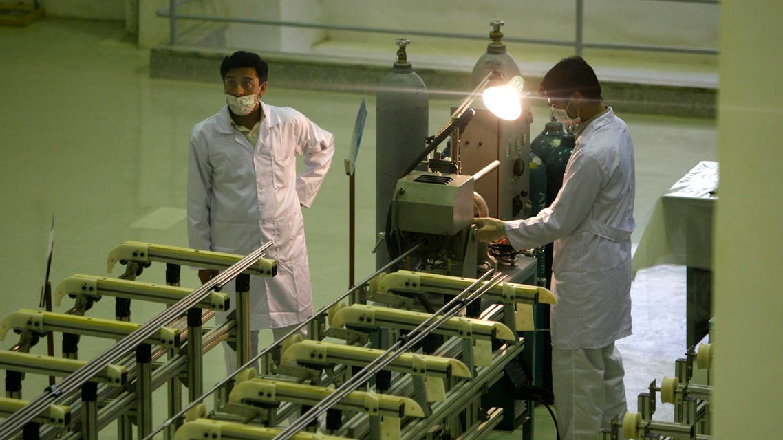 In this April 9, 2009 file picture Iranian technicians work at a new facility producing uranium fuel for a planned heavy-water nuclear reactor, just outside the city of Isfahan, 255 miles (410 kilometers) south of the capital Tehran. AP
