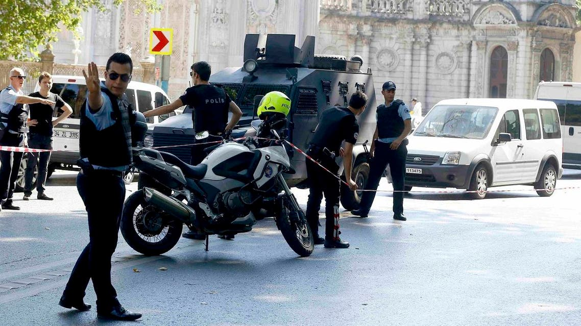 Turkish policemen secure the area after a shooting incident near the entrance to Dolmabahce palace in Istanbul