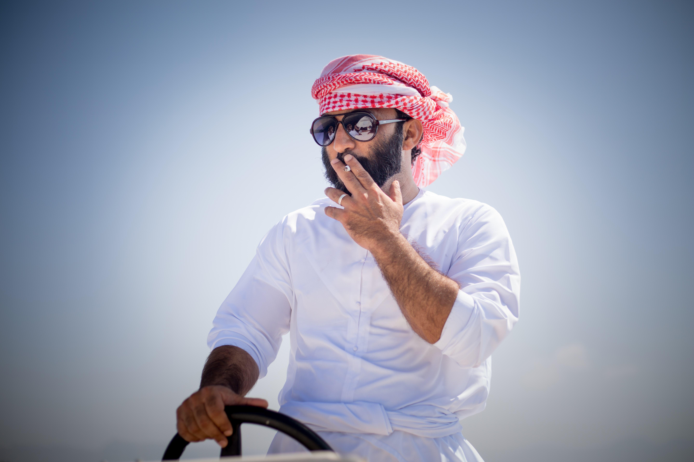 Ali Al Kumzari captains the boat to Kumzar. (Amanda Fisher/Al Arabiya News)