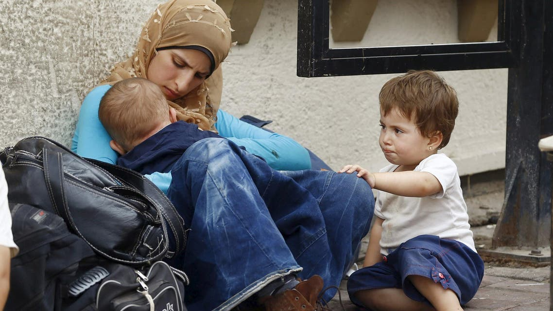 A Syrian refugee family spend the day in the Aegean port city of Izmir, western Turkey, August 10, 2015. (Reuters)
