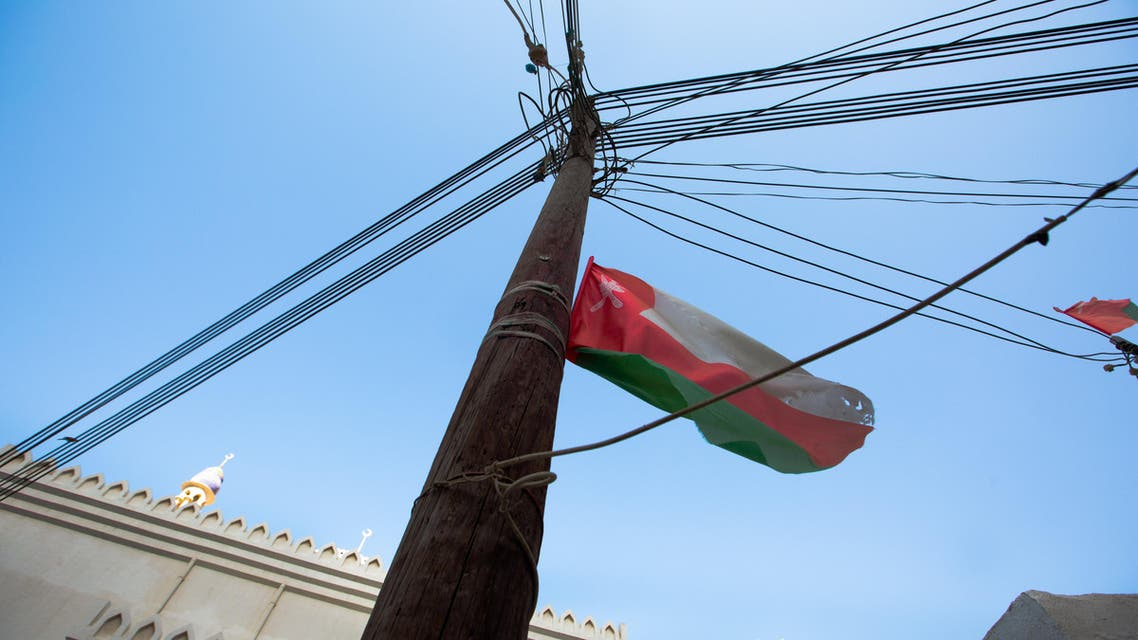 The Oman flag flies on an electricity pole in the middle of the village. (Amanda Fisher/Al Arabiya News)