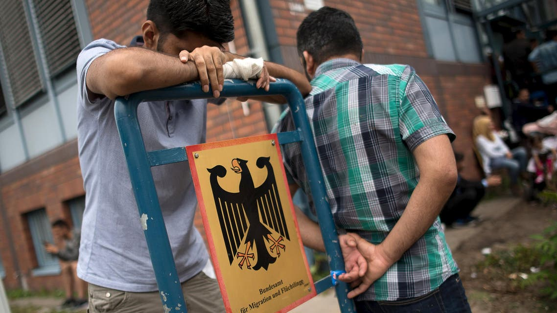 Asylum seekers wait in front of the Federal Office for Migration and Refugees (BAMF) at Berlin's Spandau district, Germany August 17, 2015. (Reuters)