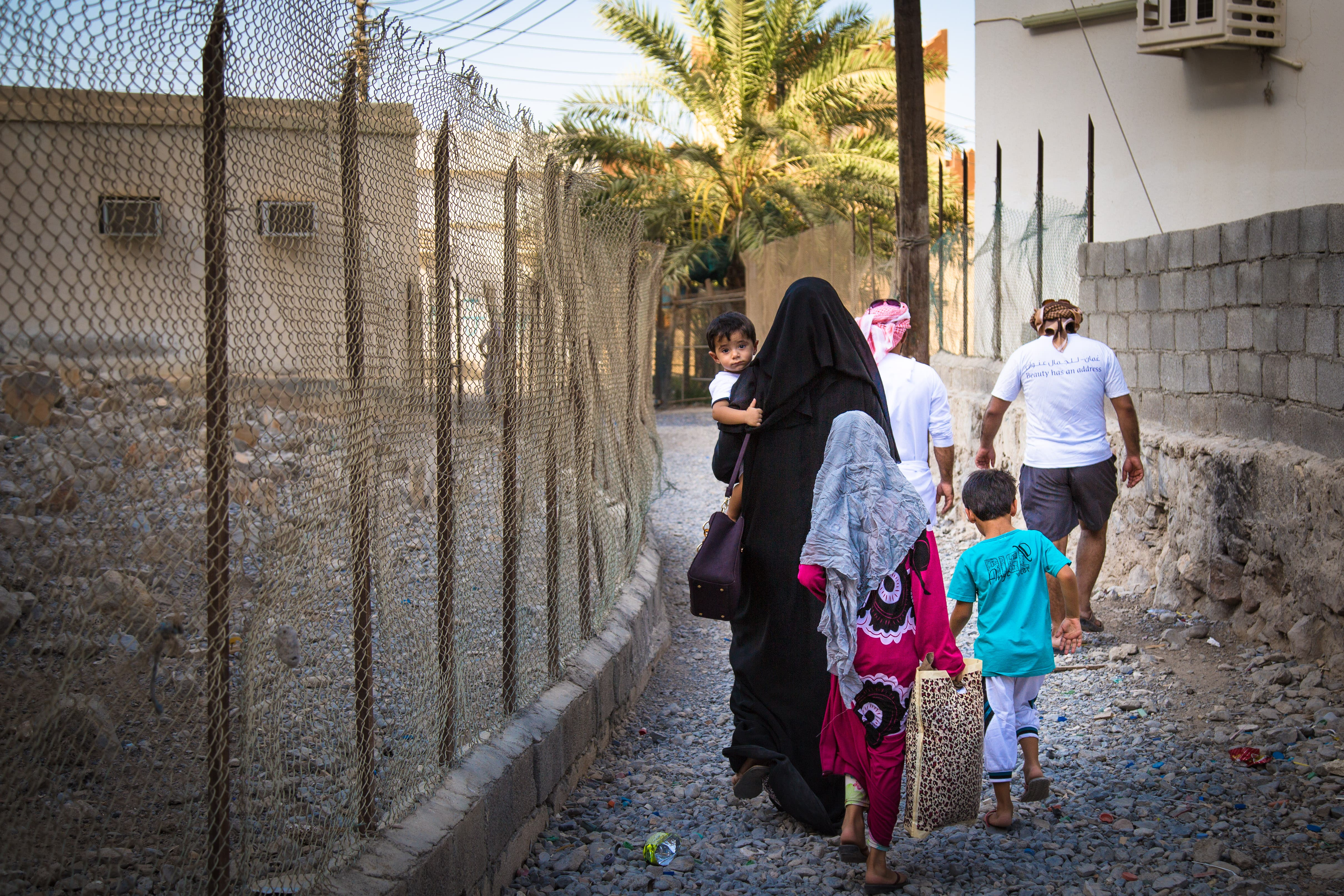 Prayer time - a rare group of Kumzaris left in the village on their way to mosque. (Amanda Fisher/Al Arabiya News)