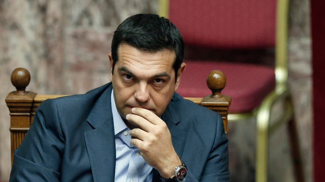 Greek Prime Minister Alexis Tsipras listens during a parliamentary session in Athens, Friday, Aug. 14, 2015. (AP)