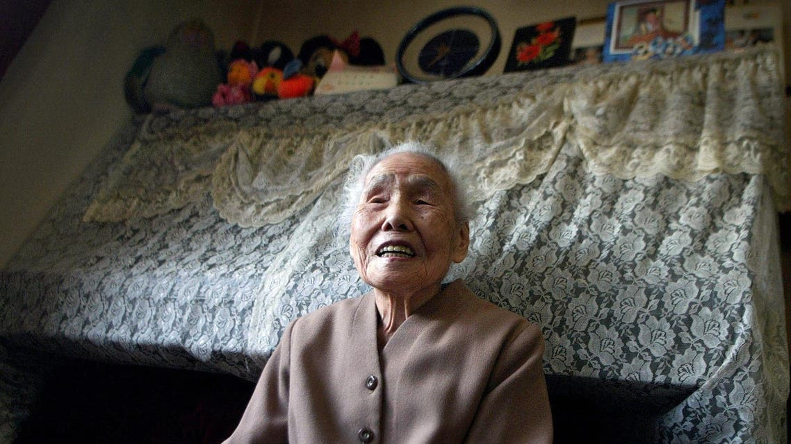 **FILE*** Kura Ikeba, 103, talks about her life as she is interviewed by the Associated Press at her home in Tokyo in this Dec 16, 2004 file photo. Dressed in a sharp dress-suit, Ikeba said her only regret is having to retire from her job as a seamstress, four years ago at the age of 99. (AP Photo/Junji Kurokawa, File)