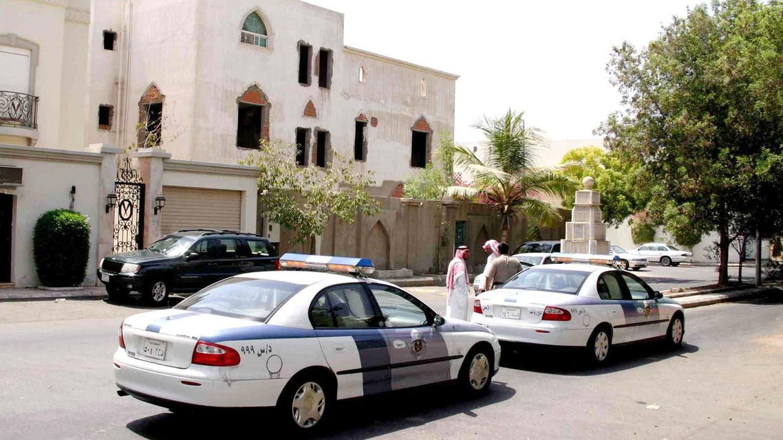 Saudi policemen investigate at the site where Laurent Barbot, a French resident working with the French defense and electronics group, Thales, was killed in the Zahra neighborhood of the port city of Jeddah, Saudi Arabia, early Sunday, Sept. 26, 2004. (AP Photo)