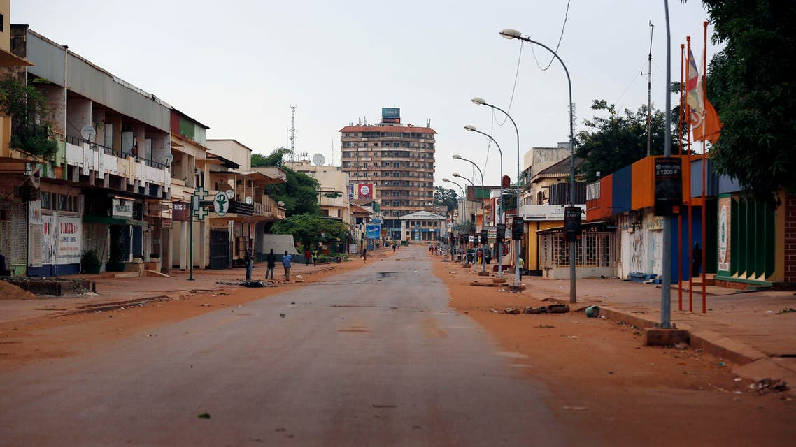 The streets of downtown Bangui remain deserted Friday May 30, 2014. Bangui came to a standstill for the second day running as demonstrators set barricades to protest Wednesday's attack on a catholic church that left 15 dead. (AP Photo/Jerome Delay)