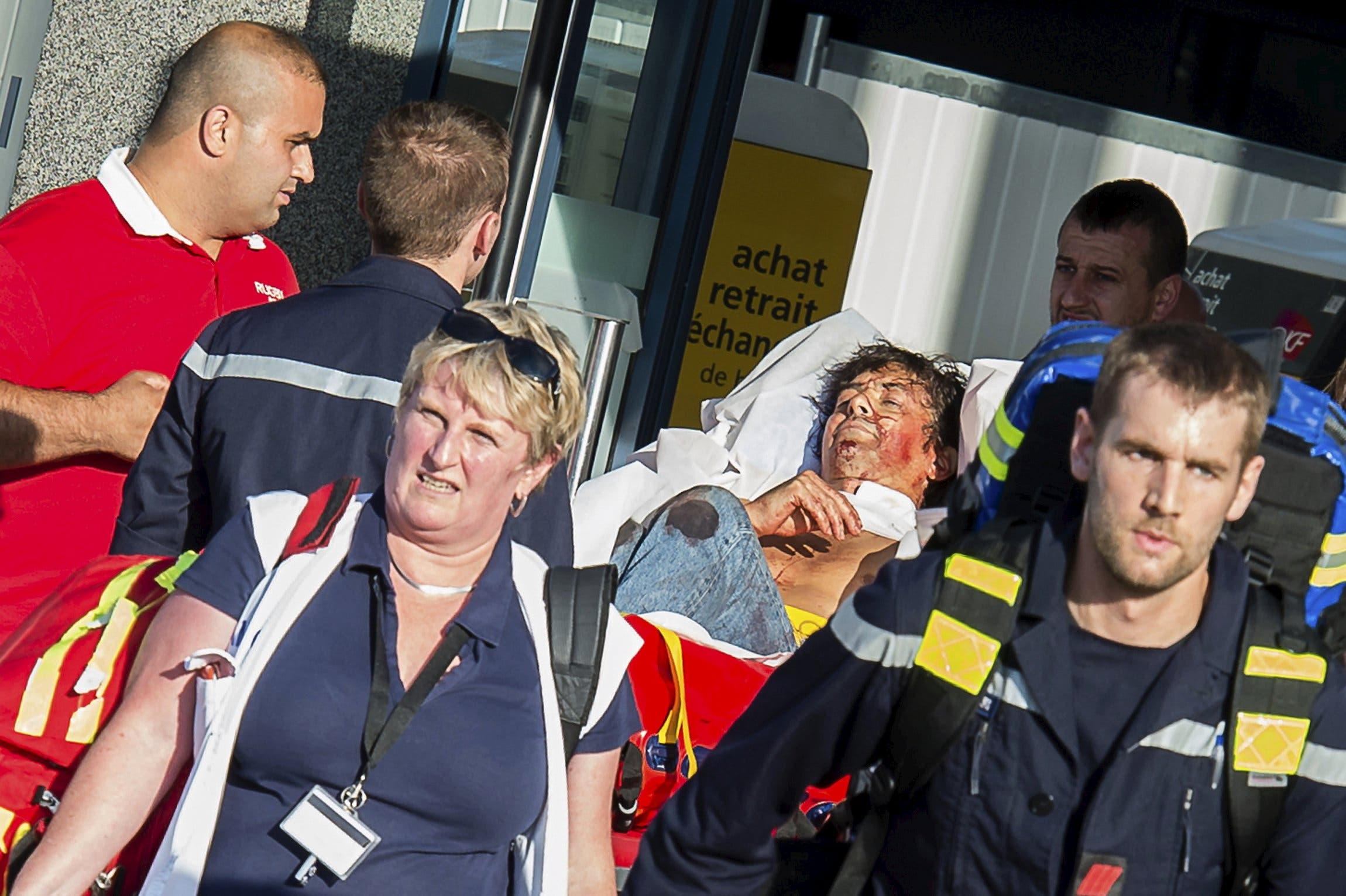 French emergency services transport a victim after a shooting on the Amsterdam to Paris Thalys high-speed train in Arras, France, August 21, 2015.  (Reuters)