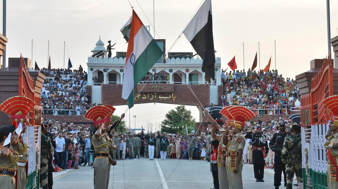 ndian and Pakistani flags are lowered during a daily retreat ceremony at the India-Pakistan joint border check post of Attari-Wagah near Amritsar, India, Tuesday, July 21, 2015.