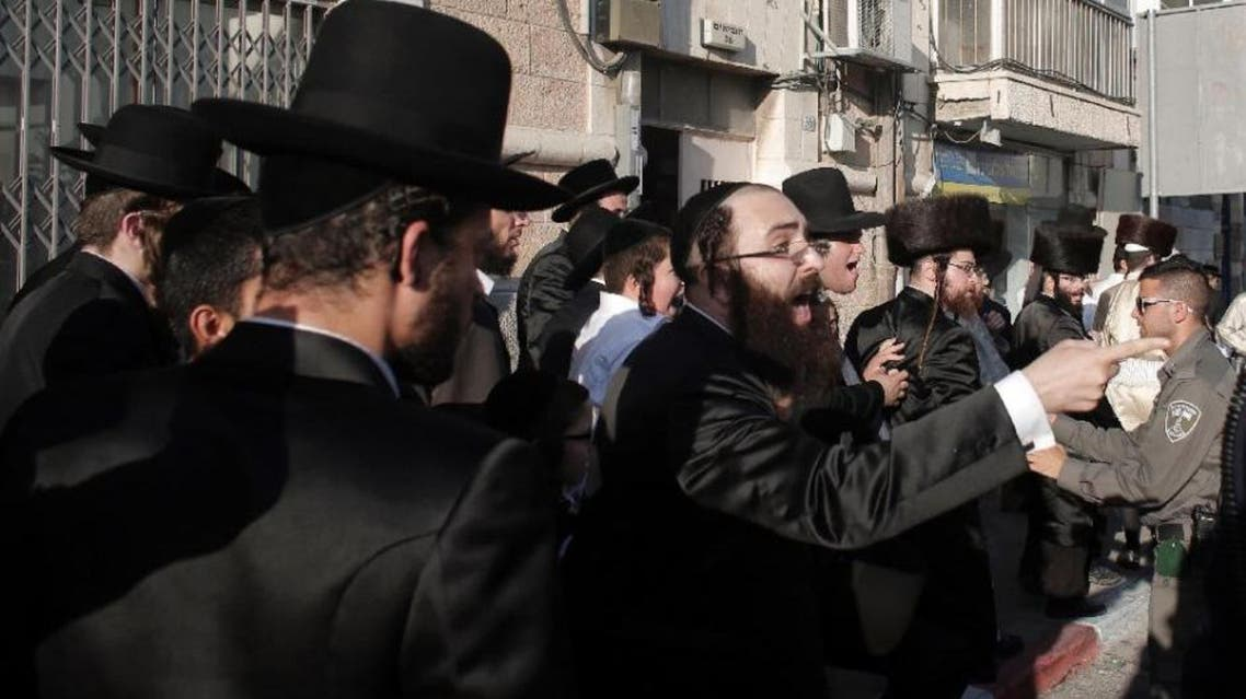 Orthodox protestors demonstrate against the opening of a new cinema complex in the city, which would open on the Jewish day of rest (AFP)