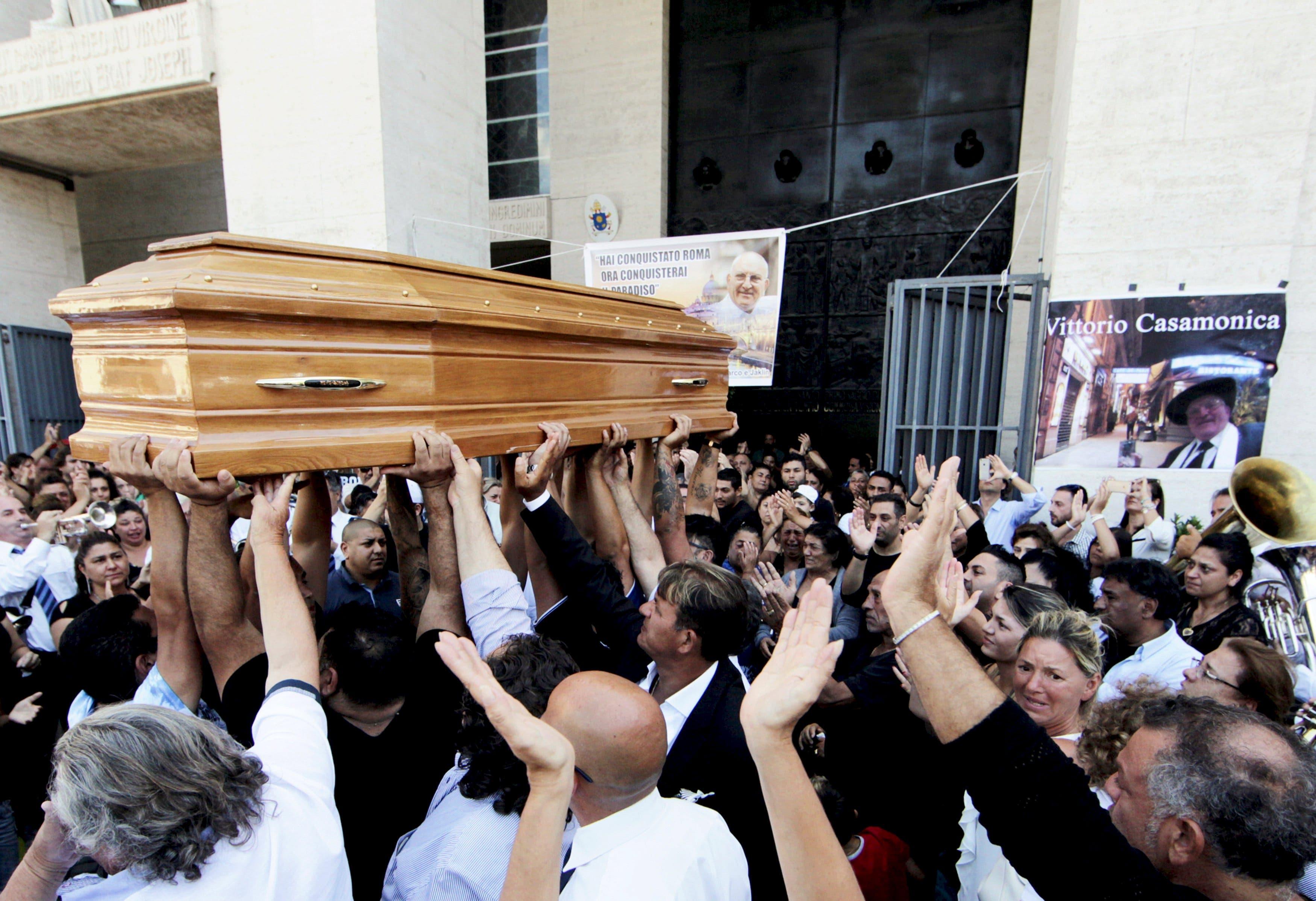 People carries the body of Vittorio Casamonica into a Roman Catholic basilica in a Rome suburb, where the funeral mass was celebrated, August 20, 2015.  (Reuters)