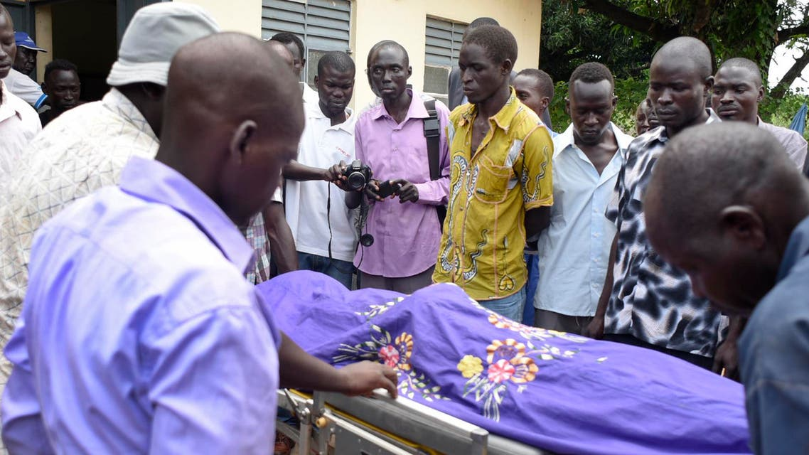 Relatives and other mourners watch as the body of South Sudanese journalist Peter Julius Moi is taken into the mortuary in Juba, South Sudan Thursday, Aug. 20, 2015.  (AP)