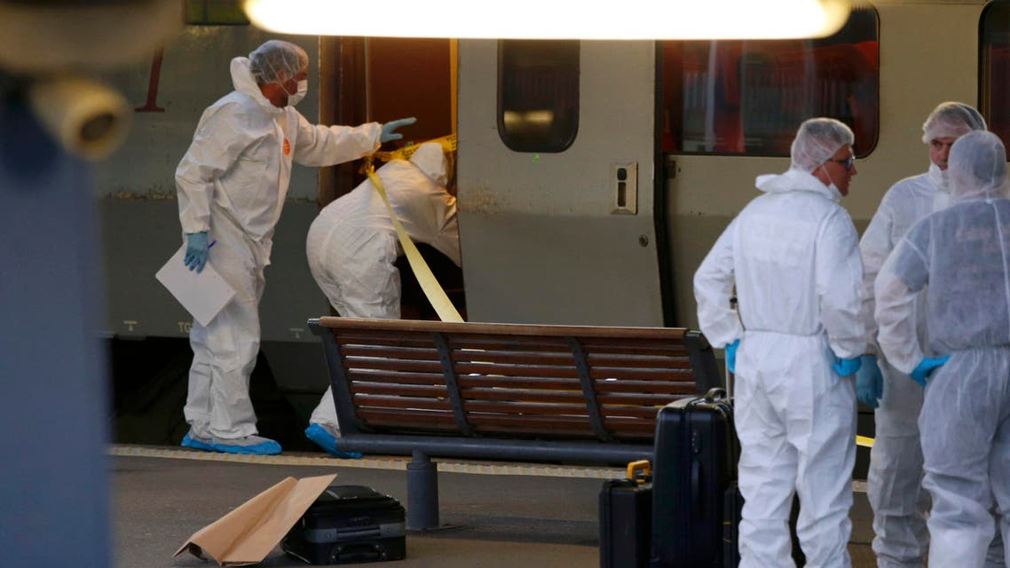 French investigating police in protective clothing prepare to enter the Thalys high-speed train where shots were fired to collect clues in Arras, France, August 21, 2015. (Reuters)