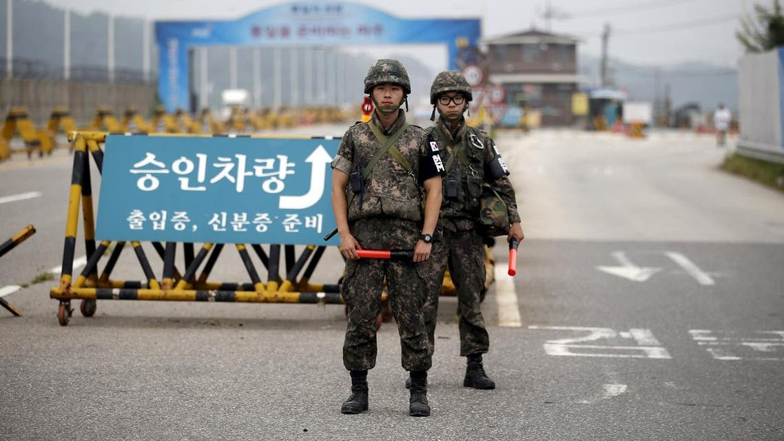 South Korean soldiers stand guard at a checkpoint on the Grand Unification Bridge which leads to the truce village Panmunjom, just south of the demilitarised zone separating the two Koreas, in Paju