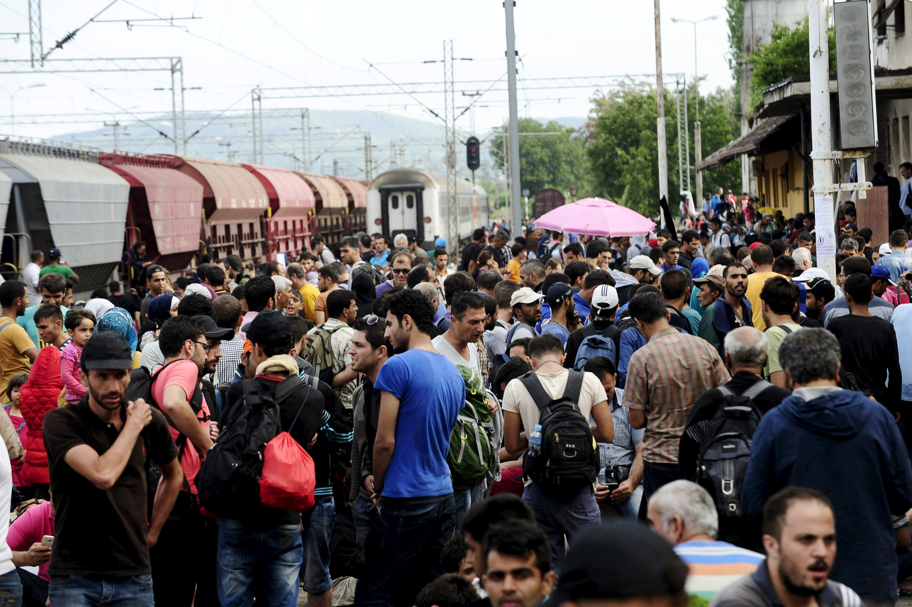 Migrants gather at Gevgelija train station in Macedonia after crossing Greece's border, Macedonia, August 22, 2015.  (Reuters)