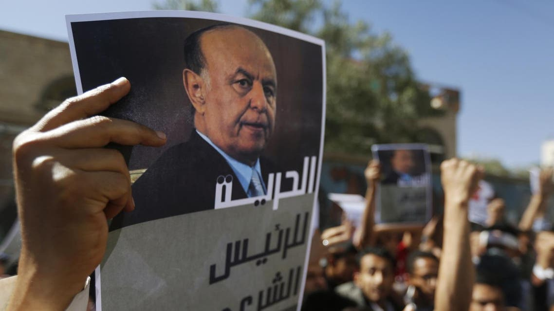 A protester holds up a poster of Yemen's President Hadi during an anti-Houthi demonstration in Sana'a. (File photo: Reuters)