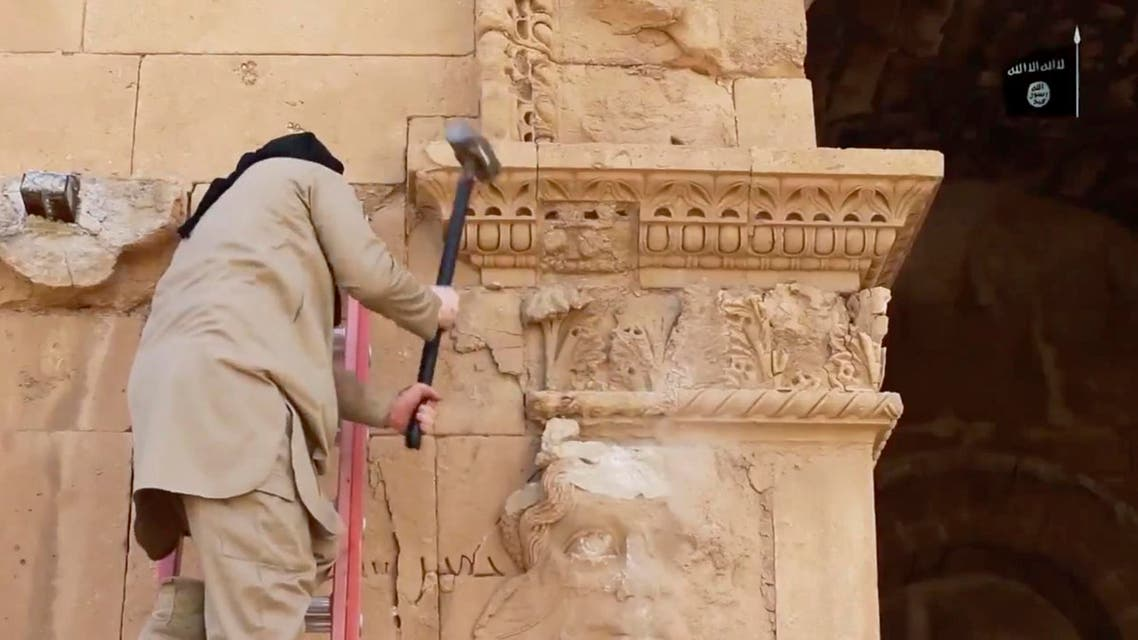 In this image made from a militant video posted on YouTube on Friday, April 3, 2015, which has been verified and is consistent with other AP reporting, a militant hammers away at a face on a wall in Hatra, a large fortified city recognized as a UNESCO World Heritage site. (Reuters)