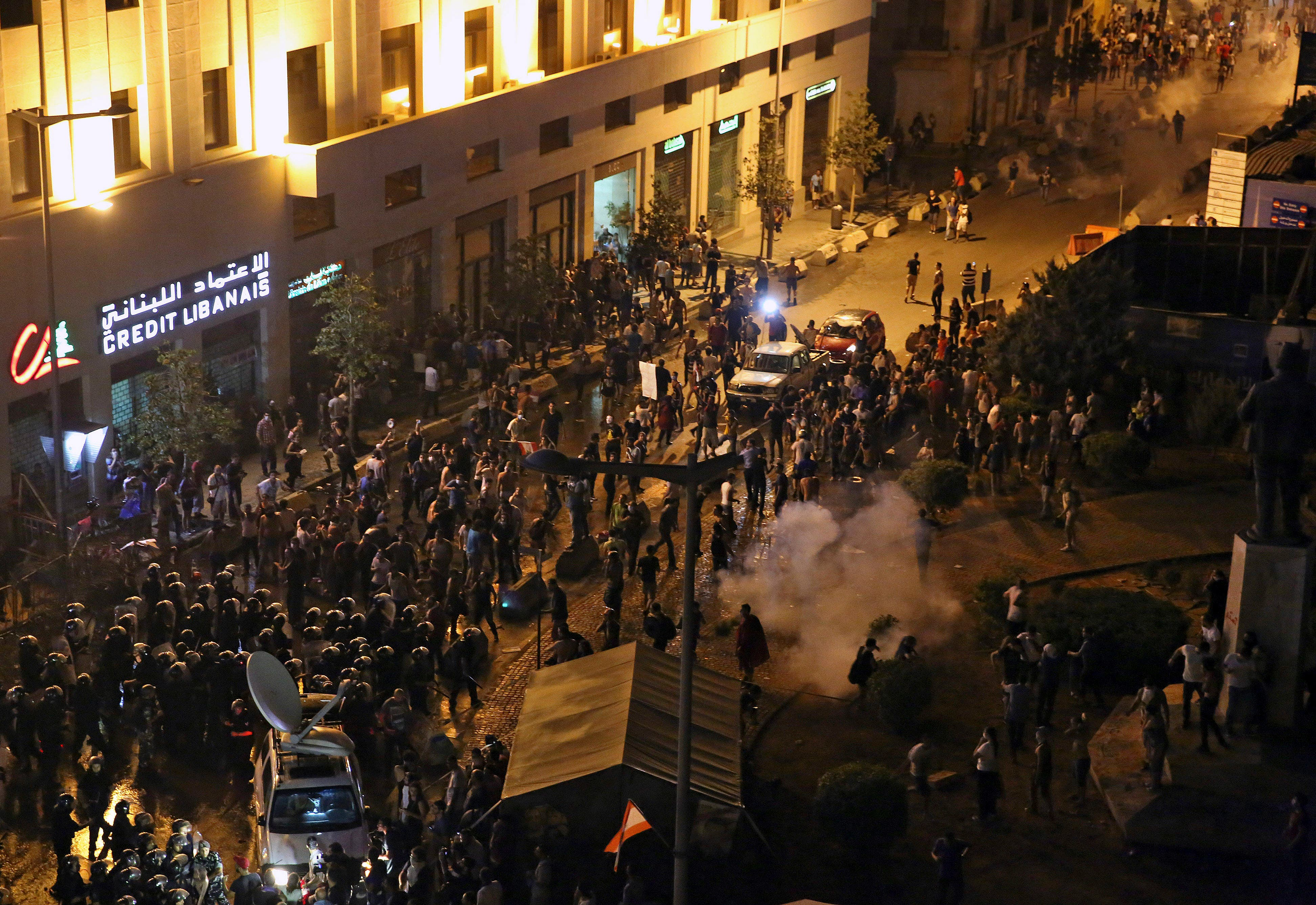 Lebanese riot police use tear gas to fend off protesters (AP)