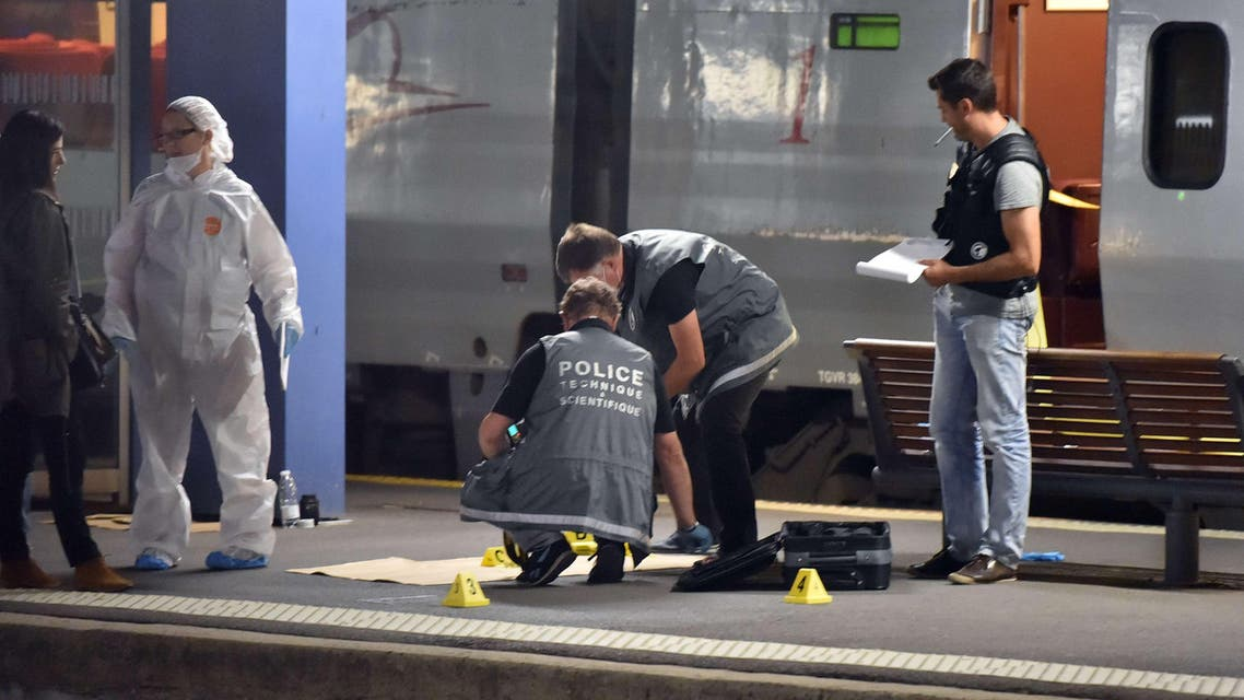 Police work on a platform next to a Thalys train of French national railway operator SNCF at the main train station in Arras, northern France, on August 21, 2015. (AFP)
