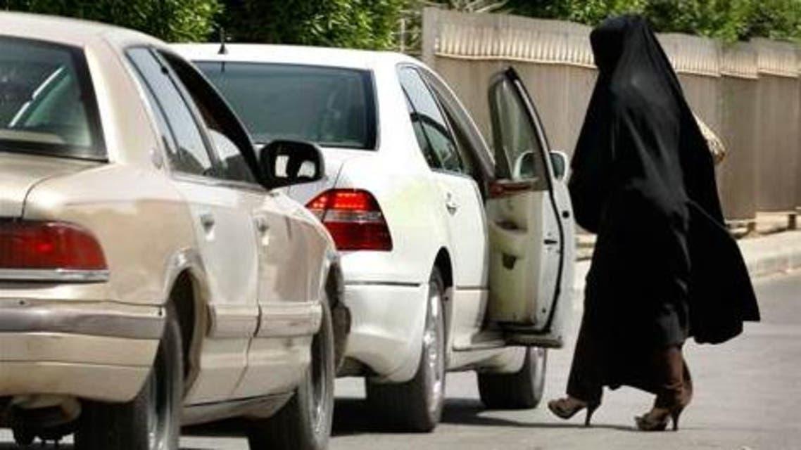 A female teacher leaves a school by car in the capital Riyadh, Saudi Arabia Sunday, April 27, 2008. (AP)