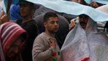 On border wait, refugees claim 'fake' Syrians try to get across