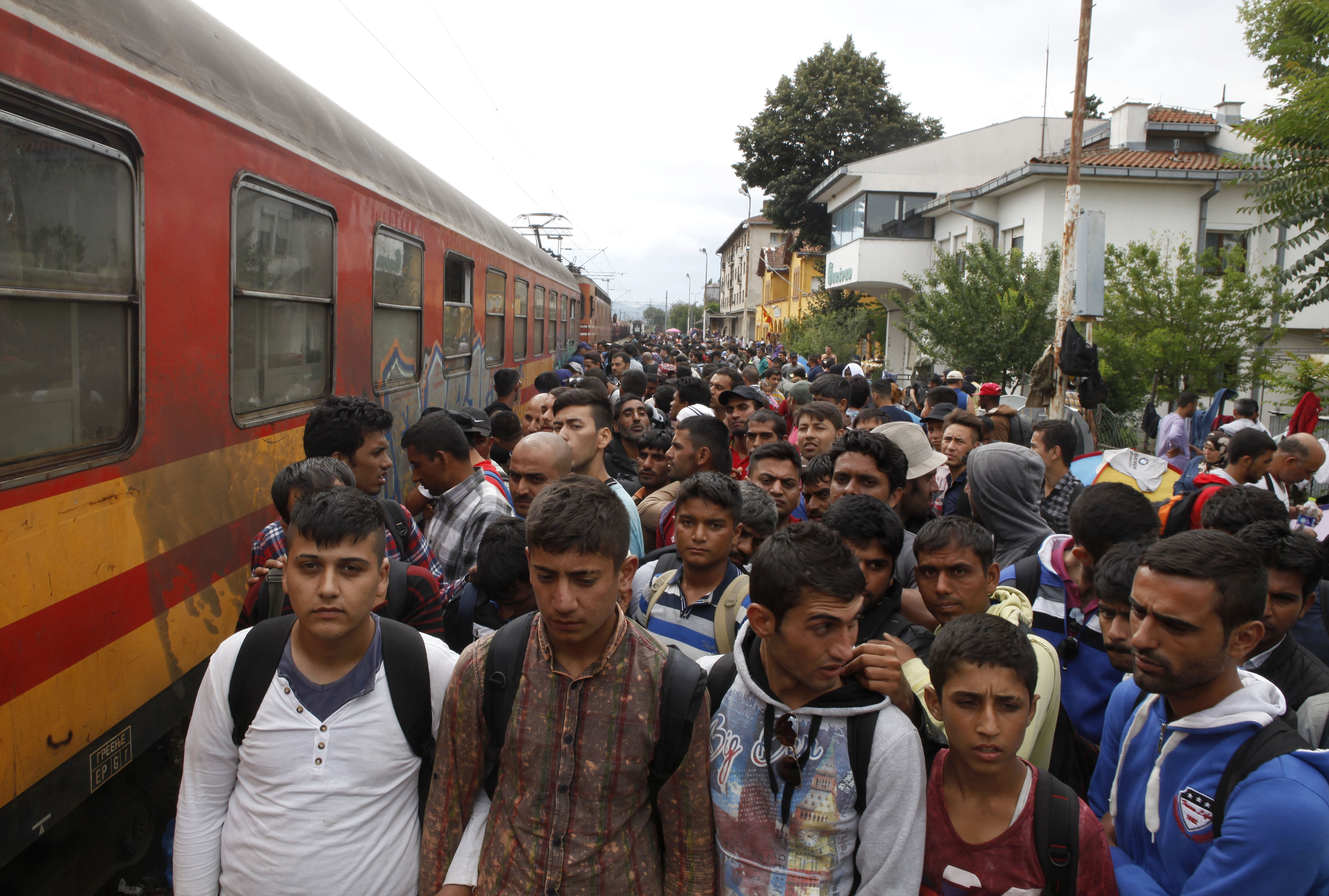 Migrants line up to board a train that will take them towards Serbia, at the railway station in the southern Macedonia's town of Gevgelija, on Saturday, Aug. 22, 2015. (AP)