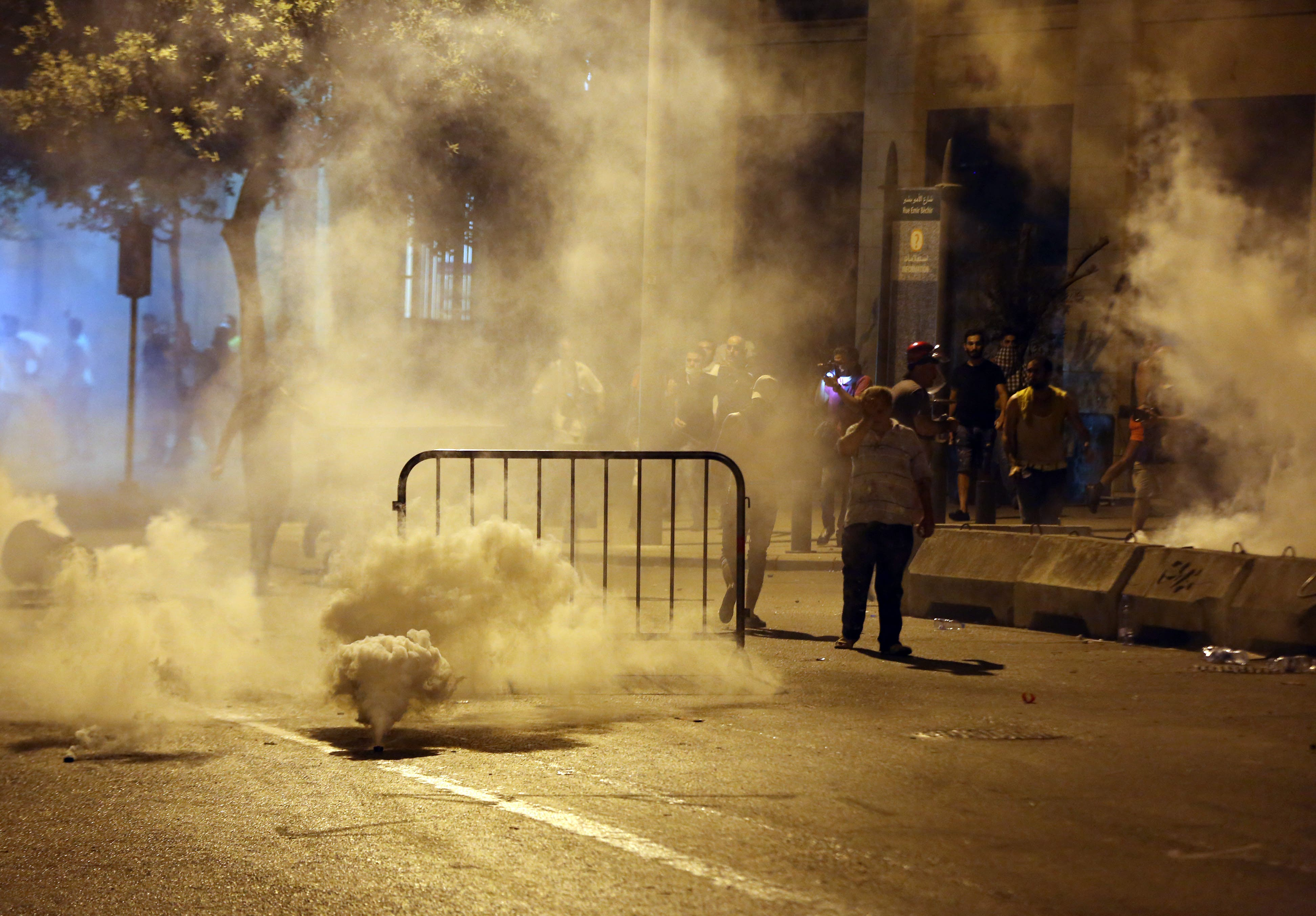 Lebanese riot police use tear gas during a protest against the ongoing trash crisis, in downtown Beirut, Lebanon, Saturday, Aug. 22, 2015. Police have unleashed tear gas and water cannons on thousands of Lebanese demonstrating in downtown Beirut against government corruption and political dysfunction that has left garbage accumulating in the streets in suburbs of the capital for over a month. (AP Photo/Bilal Hussein)