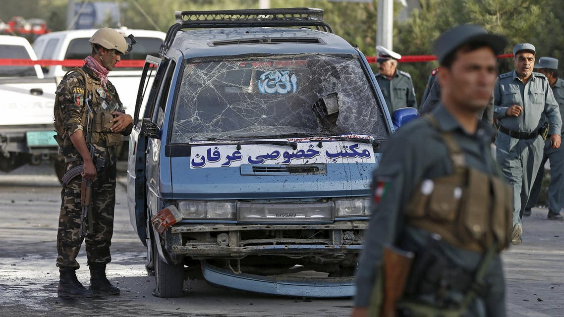 An Afghan security personnel inspects a damaged vehicle at the site of a bomb blast in Kabul, Afghanistan August 22, 2015. A car bomb exploded outside a private hospital in Kabul on Saturday killing one person and injuring 18 more, a senior health official said. REUTERS/Mohammad Ismail