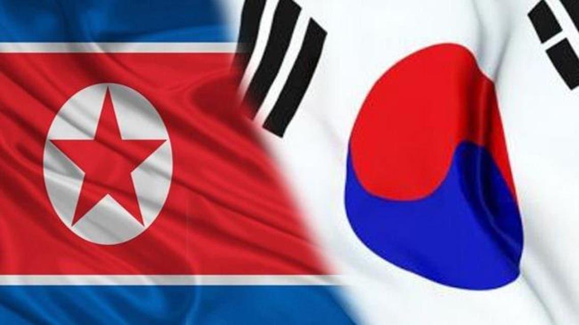 علم كوريا الشمالية و علم كوريا الجنوبية
