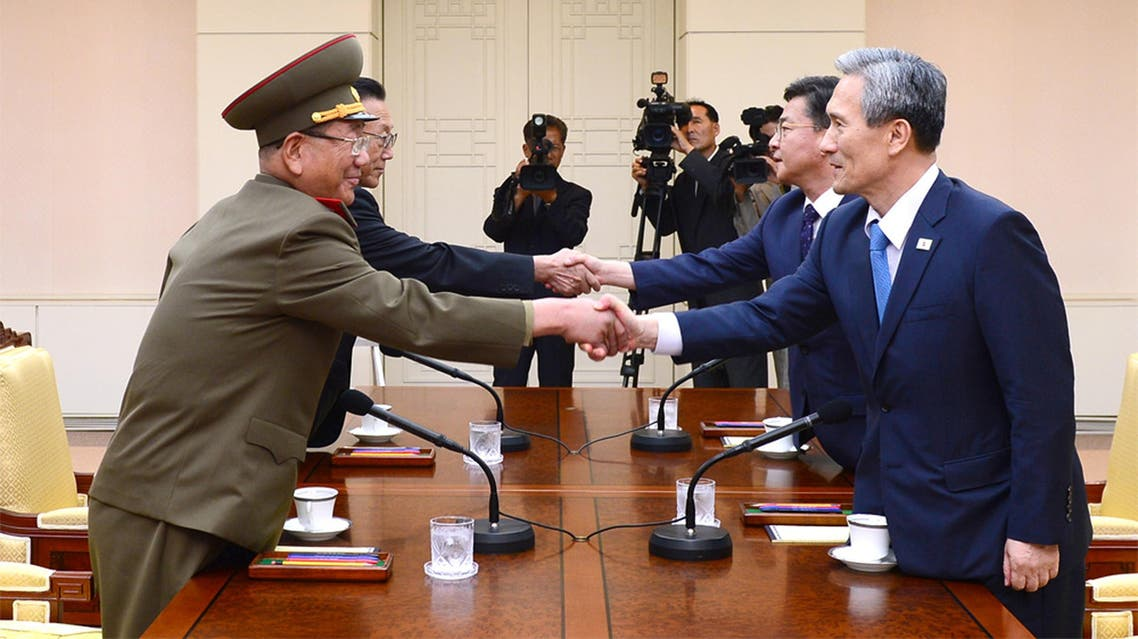 South Korean Unification Ministry, South Korean National Security Director, Kim Kwan-jin, right, and Unification Minister Hong Yong-pyo, second from right, shake hands with Hwang Pyong So, left, North Korea' top political officer for the Korean People's Army, and Kim Yang Gon, a senior North Korean official responsible for South Korean affairs. file photo AP