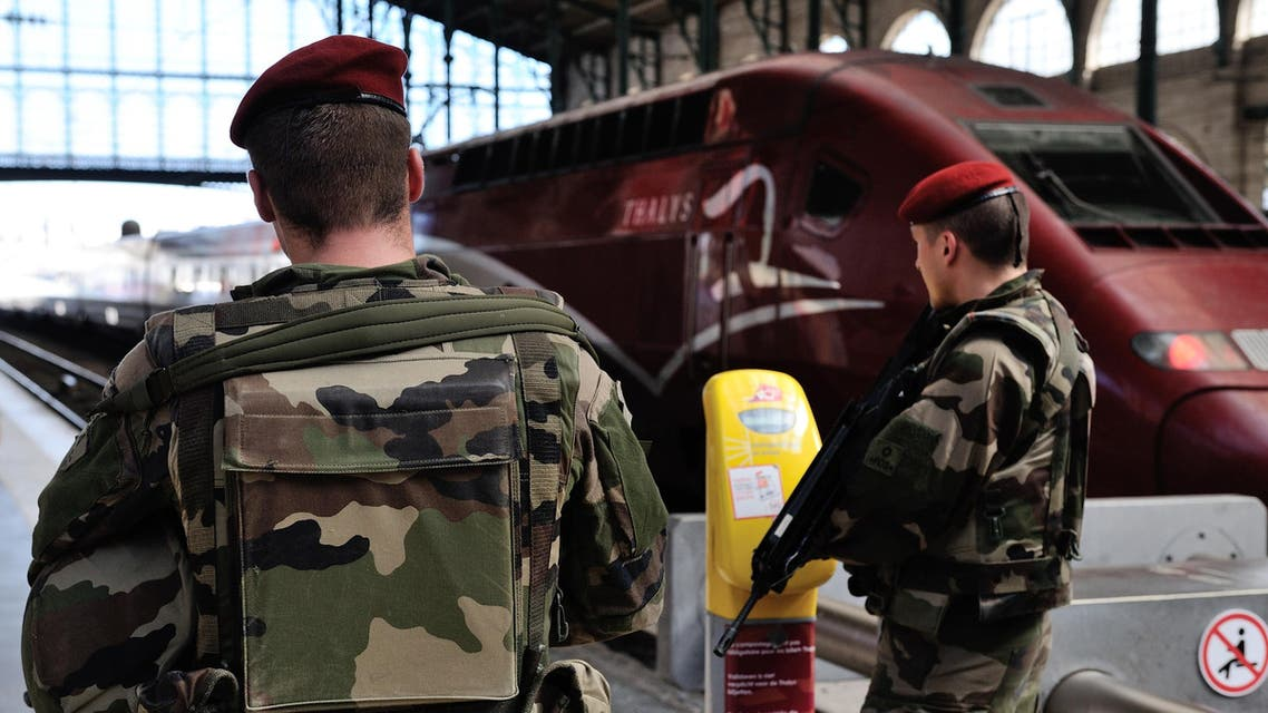 French soldiers patrol at Gare du Nord train station in Paris, France, Saturday, Aug. 22, 2015. A gunman prepared to open fire with an automatic weapon on a high-speed train traveling from Amsterdam to Paris on Friday, wounding several people before being subdued by passengers, officials said. (AP Photo/Binta)