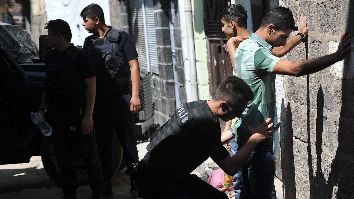 Turkish police officers search youths as they conduct a security operation in Diyarbakir, southeastern Turkey, Saturday, Aug. 15, 2015. (AP)