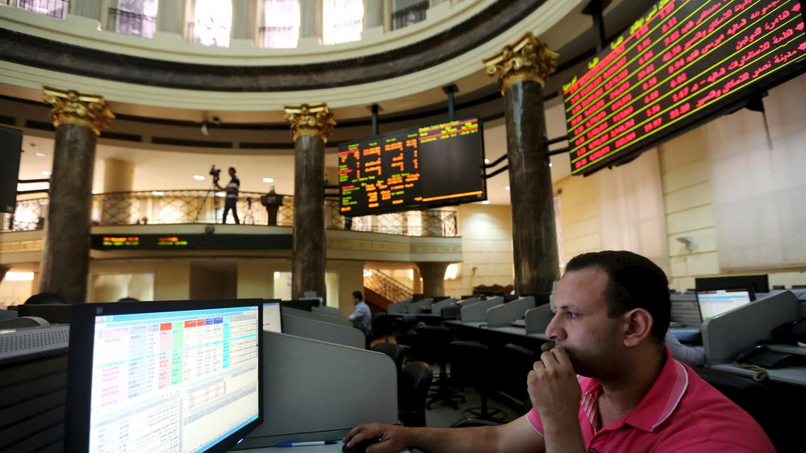 A trader works at the Egyptian stock exchange in Cairo, August 23, 2015. Egypt's central bank kept the pound steady at 7.73 per dollar at a foreign exchange auction on Sunday, and the currency was weaker at exchange bureaus. REUTERS/Mohamed Abd El Ghany