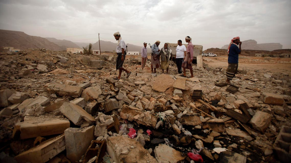 In Yemen, tribesmen stand on the rubble of a building destroyed by a U.S. drone air strike, that targeted suspected al-Qaeda militants on Feb. 3, 2013. (Reuters)