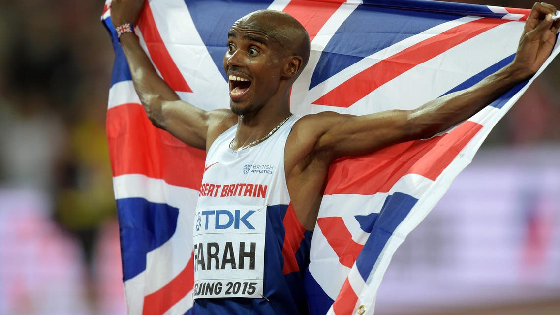 Mo Farah (GBR) poses with a British flag after winning the10,000m in 27:01.13 during the IAAF World Championships. (Reuters)