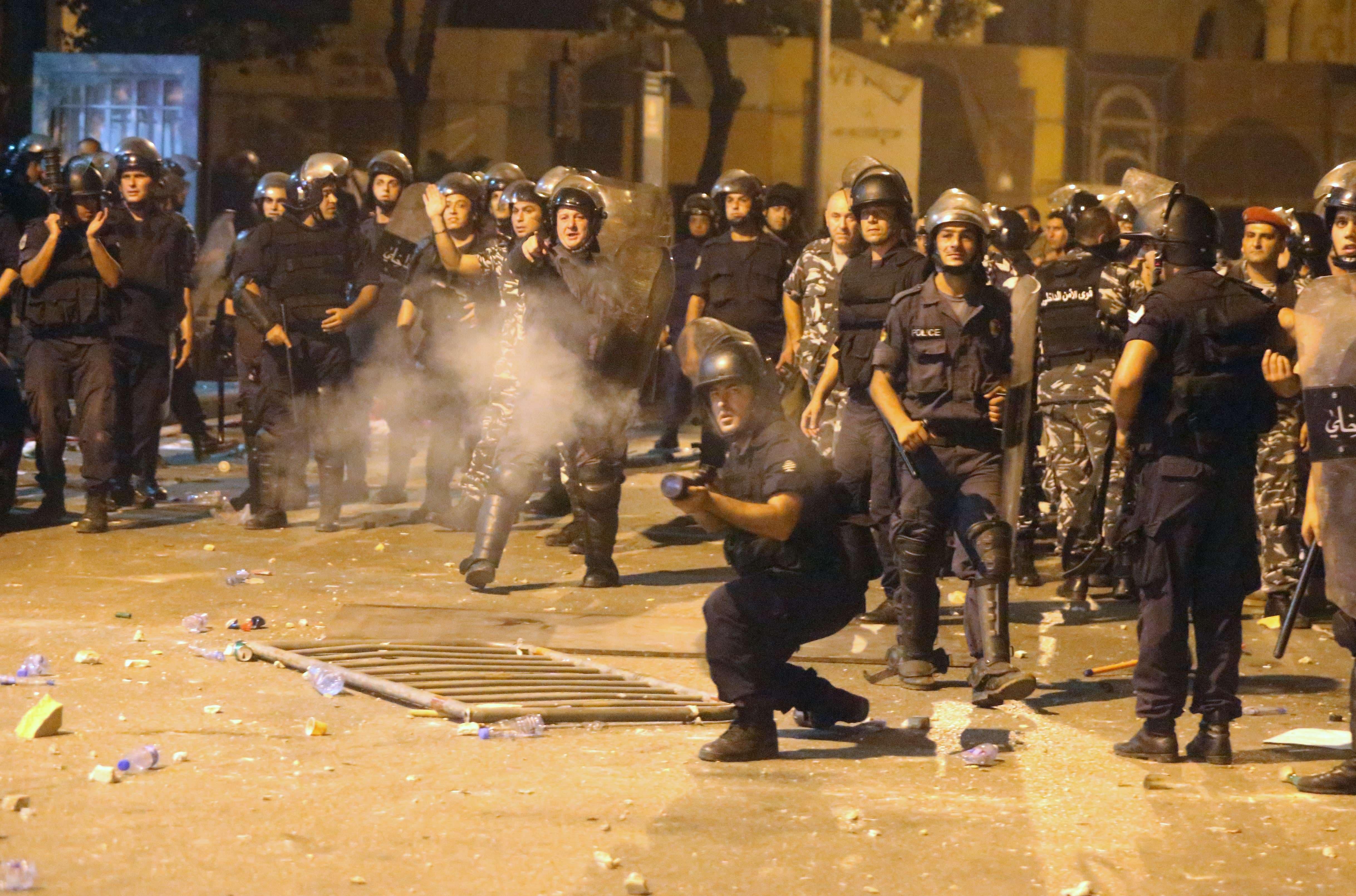 Lebanese riot police seen firing tear gas