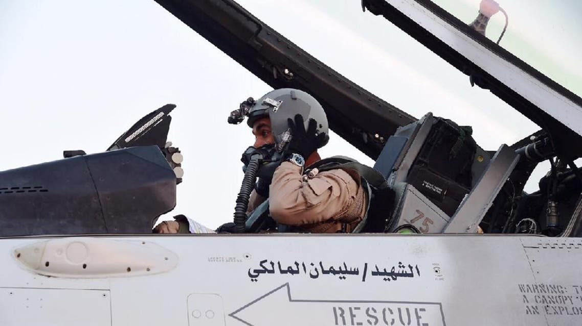 A pilot sitting in a cockpit of a fighter jet of the UAE armed forces on the tarmac of a Saudi air force base after raids against Houthis in Yemen (File photo: AFP)