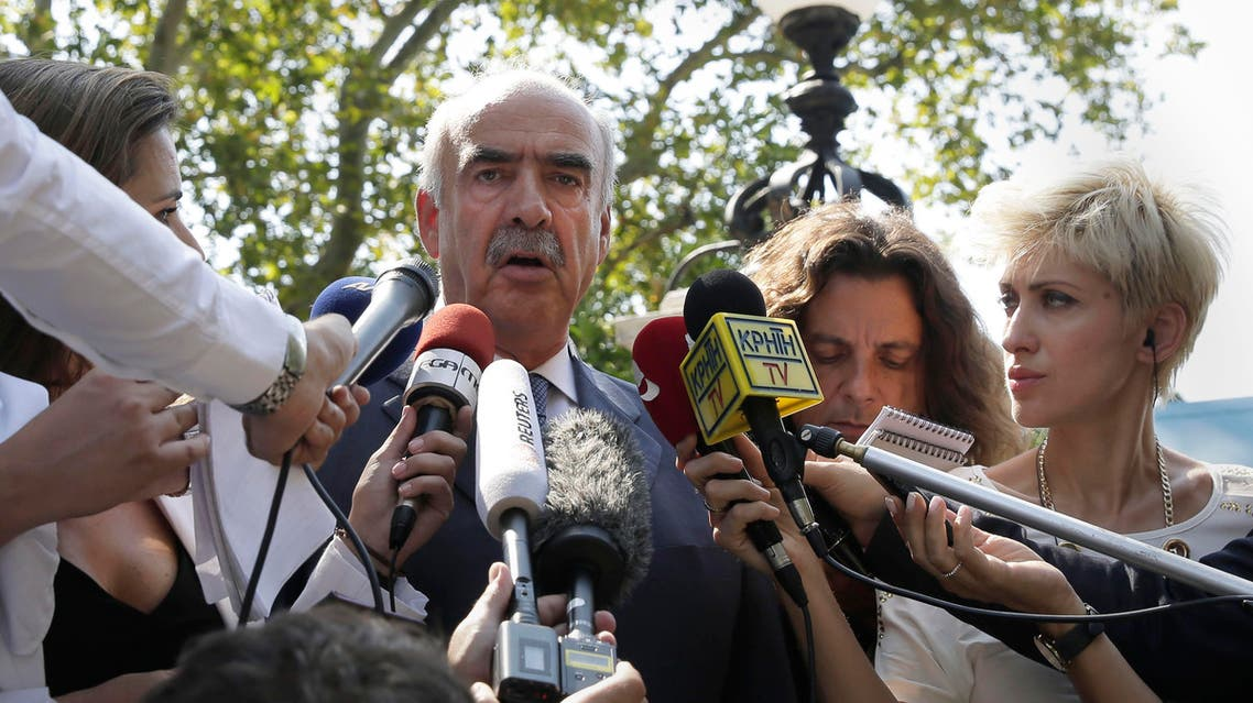 Conservative New Democracy party head Evangelos Meimarakis answers questions to journalist after his meeting with Greek President in Athens, Friday Aug. 21, 2015. AP