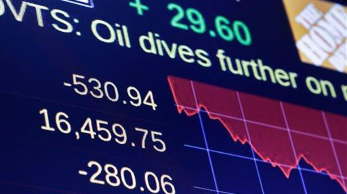 A screen above the trading floor of the New York Stock Exchange shows the closing numbers, Friday, Aug. 21, 2015. The Dow Jones industrial average plunged more than 530 points and is in a correction amid a global sell-off sparked by fears about China's slowing economy. Oil tumbled below $40 per barrel for the first time since the financial crisis. (AP Photo/Richard Drew)