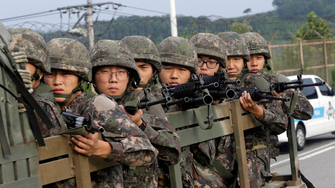 South Korean army soldiers ride on a truck in Paju, south of the demilitarized zone that divides the two Koreas, South Korea, Monday, Aug. 24, 2015. AP
