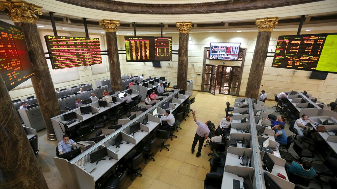 Traders work at the Egyptian stock exchange in Cairo, August 23, 2015. Reuters