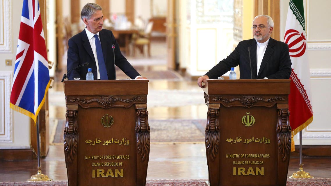 British Foreign Secretary Philip Hammond, left, speaks during a press conference with Iranian Foreign Minister Mohammad Javad Zarif, in Tehran, Iran, Sunday, Aug. 23, 2015. AP