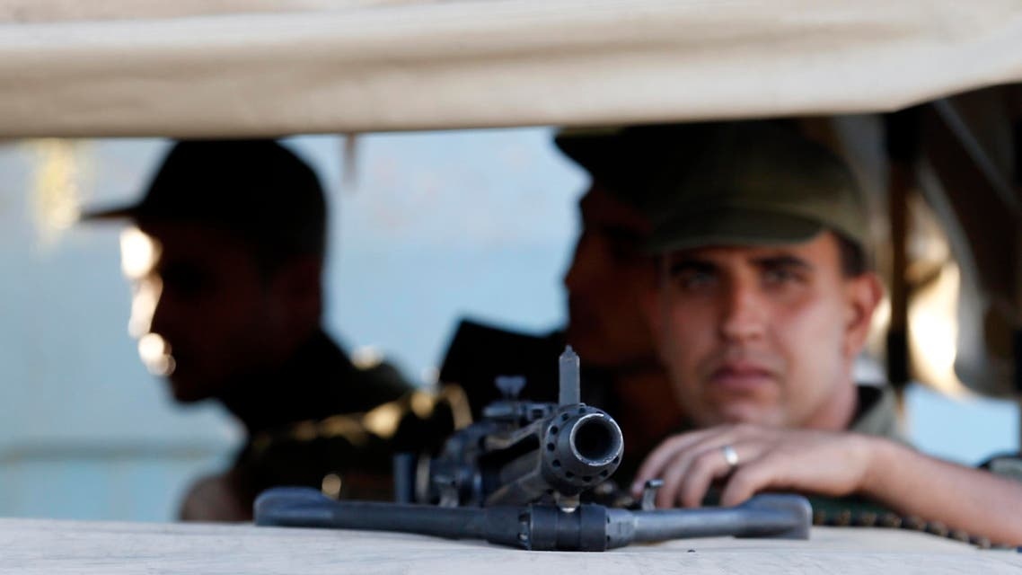 Tunisian army soldiers guard the street near the attacked Imperial Marhaba hotel in Sousse, Tunisia, Saturday, June 27, 2015. AP